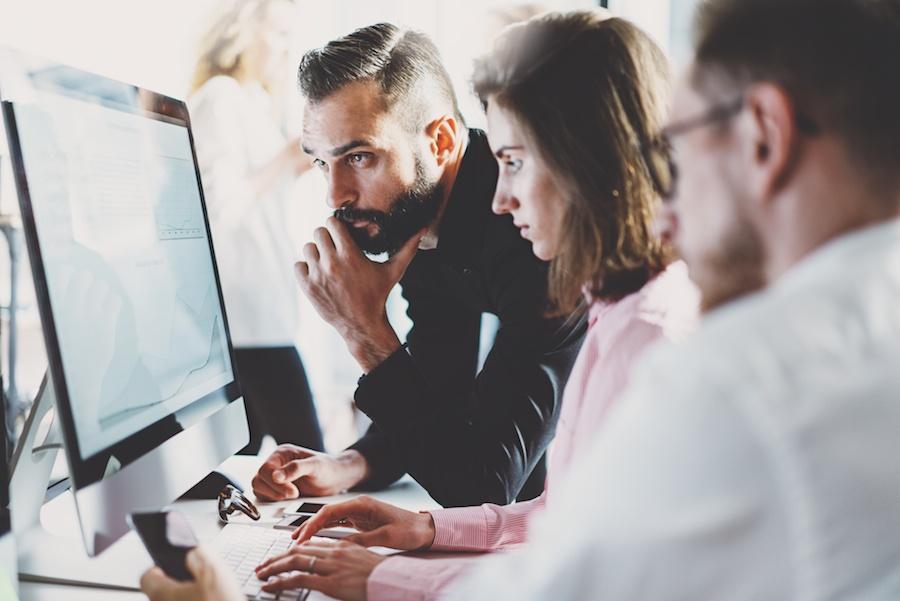 coworkers-looking-at-computer.jpg
